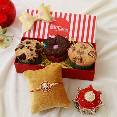 Ganesha dial metallic rakhi with assorted sugar free muffins in a ganesha dial metallic rakhi with assorted sugar free muffins in a gift box negle Images