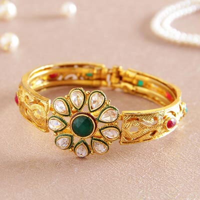 Golden Bangle Lined in Coral Stones