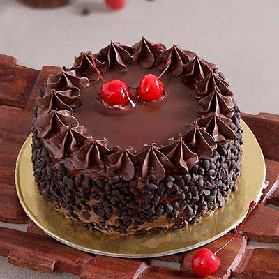 Easter gifts online buy send easter baskets presents for kids half kg round chocolate cake with chocolate chips cherry toppings negle Images