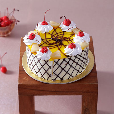 Easter gifts online buy send easter baskets presents for kids half kg round pineapple cake with cherry cream toppings negle Images