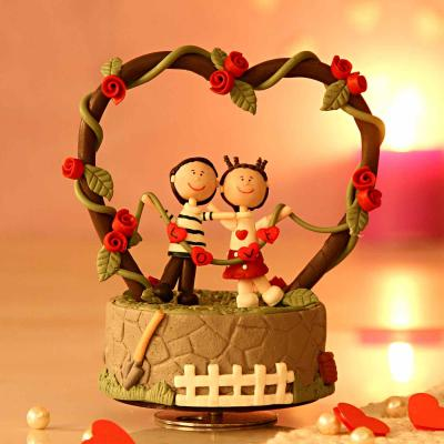 musical rotating romantic love couple