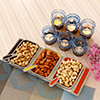 Attractive Glass Candle Votives with Dryfruits in Colourful Bowl Shaped Tray