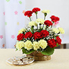 Basket Arrangement of 20 Mix Carnations with Kaju Katli Box