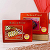 Batisa Slice with a Box of Badam Pinni