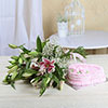 Bunch of 10 Pink Lilies with 1.5 Kg Heart Shaped Strawberry Cake