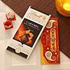 Designer Rakhi with Lindt caramel chocolate bar and roli chawal kit
