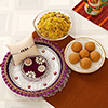 Elegant Rakhi in Puja Thali with Sweets and Namkeen