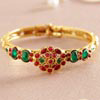 Golden Bangle Lined with Coral Stones