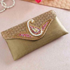 Golden Raw Silk Clutch With Zardosi Work