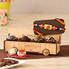 Om Rakhi With 4 Pcs Choco Truffles Cart