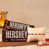 Rakhi with Two Bars of Hershey's Chocolates and a Roli-Chawal Kit