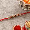 Sparkling Rudraksh Rakhi in Thread