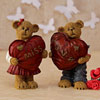 Teddy Couple Holding Hearts