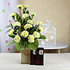 Vase Arrangement of 15 Yellow Carnations with 2 Bars of Temptation