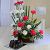 Vase Arrangement of 20 Mix Carnations with 1.5 Kg Heart Shaped Chocolate Cake