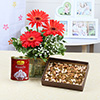 Vase Arrangement of 3 Red Gerberas with Rassogulla 1 Kg & 400 Gms Dryfruits
